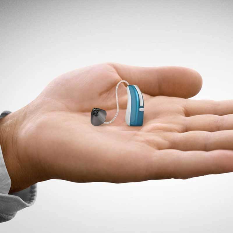 Hand with Hearing aid changing to new hearing specialist