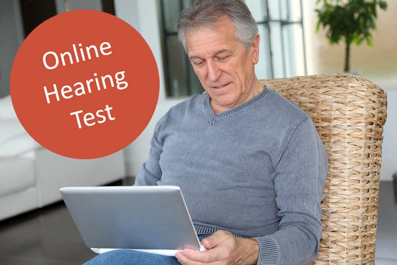 Free online hearing test aids man with pc