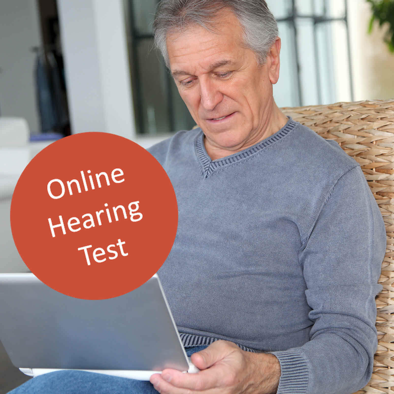 Man using pc for online hearing test