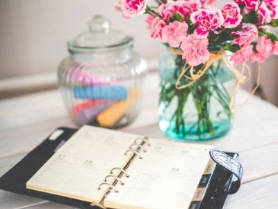 Diary on table with flowers