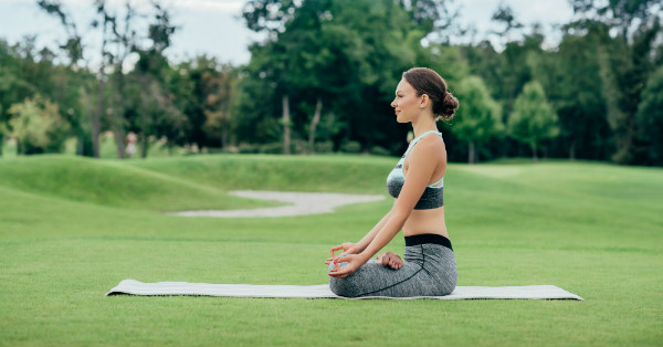 Woman practicing yoga and the positive effects on hearing loss