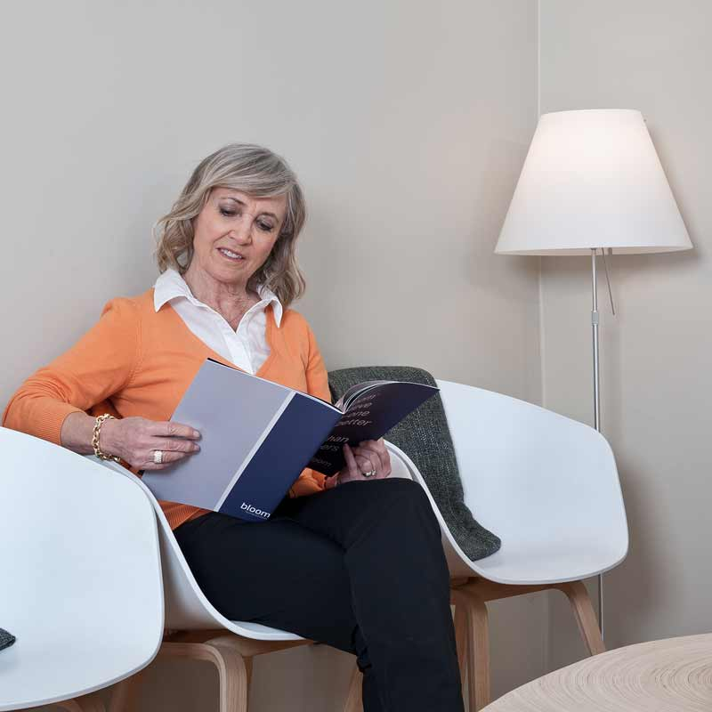 Lady with hearing loss waiting for free hearing test