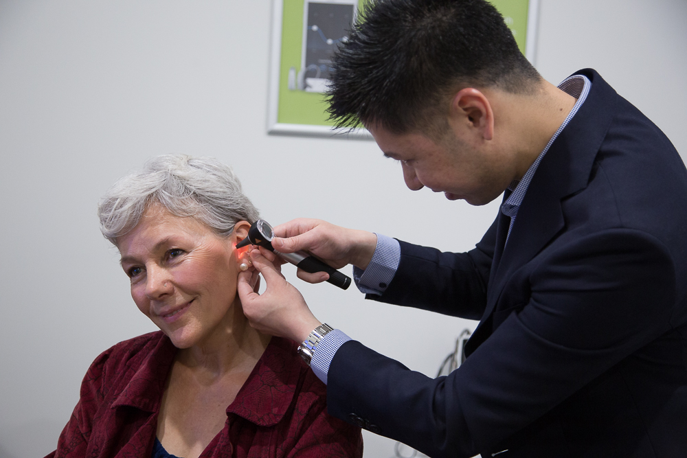 Audiologist performing an Ear Inspection | Bloom Hearing