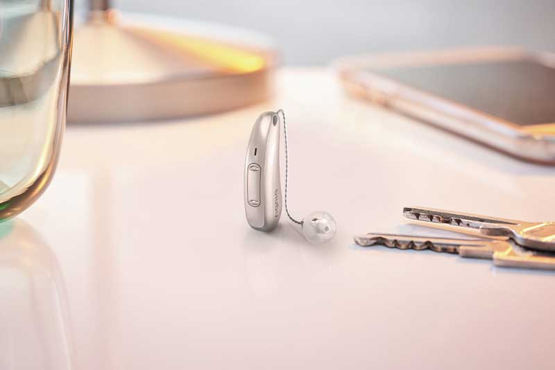 Signia Xperience Pure Charge&Go X hearing aid on table