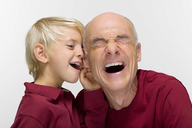 child with a grandpa using hearing aids